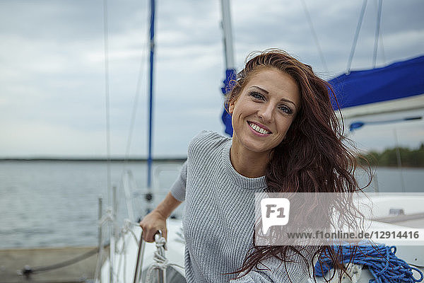 Portrait of woman  having fun on a sailing boat