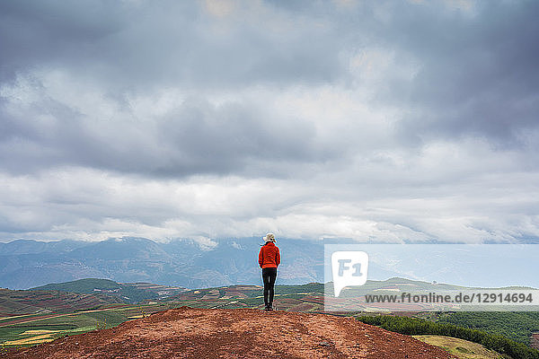 China  Yunnan province  Dongchuan  Red Land  young woman standing on viewpoint