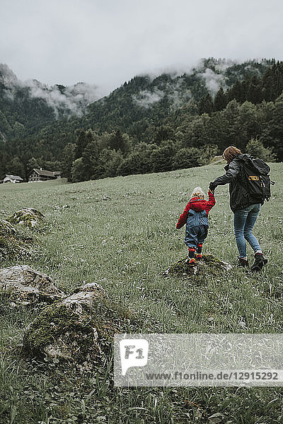 Austria  Vorarlberg  Mellau  mother and toddler on a trip in the mountains