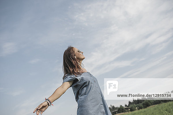 Relaxed woman on a rural field