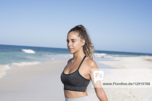 Spain  Canary Islands  Fuerteventura  young female athlete on the beach