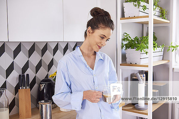 Young woman at home in kitchen