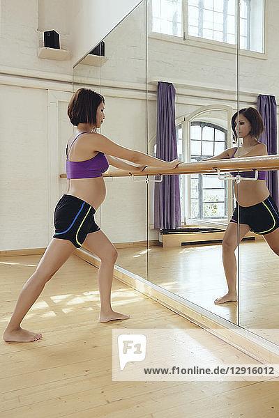Pregnant woman training in dance studio