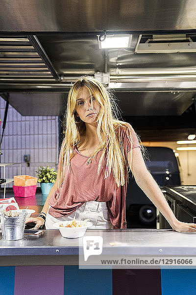 Portrait of young woman in a food truck