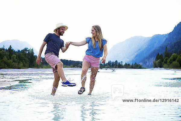 Young couple in the water  splashing water