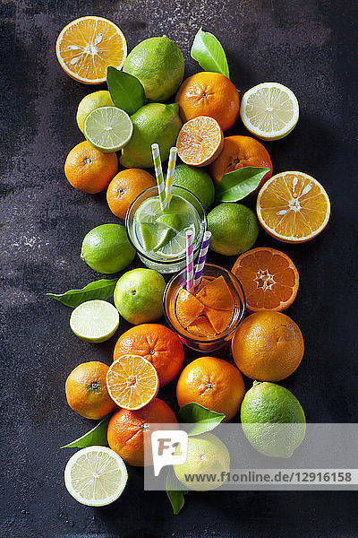 Limes  lemons  oranges and tangerines om dark background