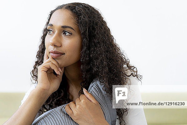 Young woman sitting at home  thinking