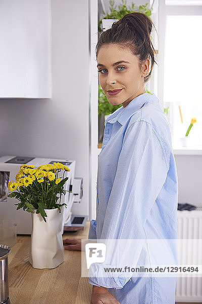 Young woman at home  standing in kitchen