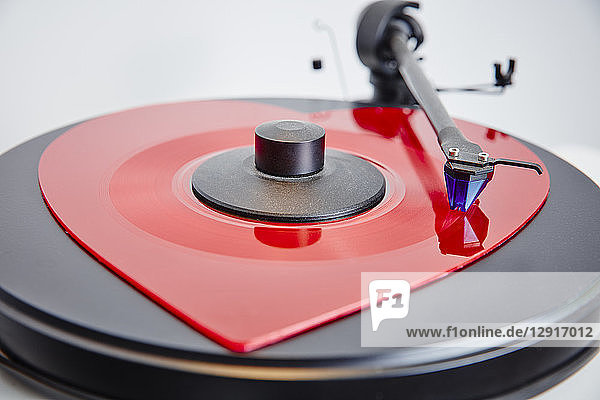 Heart-shaped vinyl record on record player