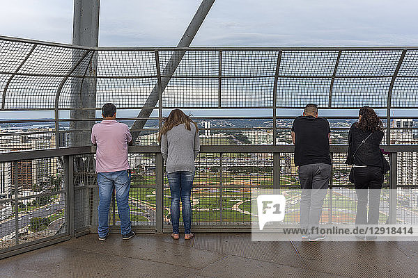 Rear view of group of tourists watching the view from TV Tower in central Brasilia  Brazil