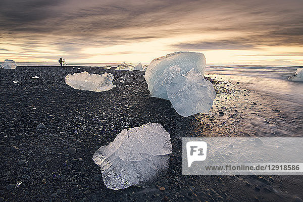 Pieces of ice lying on¬Ýlakeshore¬Ýof¬ÝJokulsarlon¬Ýat dusk  Iceland