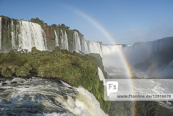 Scenic view of rainbow against splashing Iguazu Falls at Devils Throat chasm  Parana  Brazil