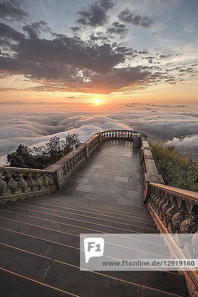 View of steps at Corcovado mountain above clouds at sunset  Rio de Janeiro  Brazil