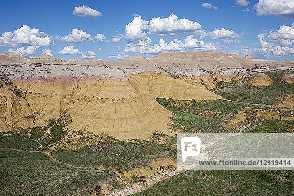 Scenic view of clouds over rock formations of Badlands National Park  South Dakota  USA