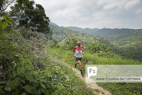 View of man trail running inLosLimones Xicotepec  Puebla State  Mexico