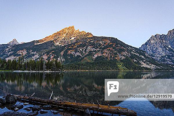 Majesticmountain reflecting in calm lake  Tetons National Park  Wyoming  USA