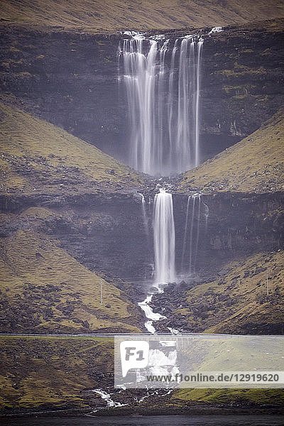 Majestic natural scenery with Fossa waterfall,  Faroe Islands
