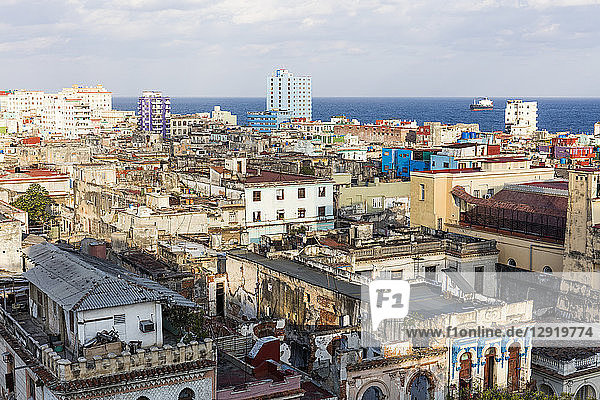 View over old building rooftops in Centro Habana  and Straits of Florida  Havana  Cuba  West Indies  Caribbean  Central America
