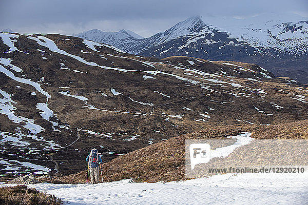 A walker at the top of the Devils Staircase while hiking along the West Highland Way near Glencoe in the Scottish Highlands  Scotland  United Kingdom