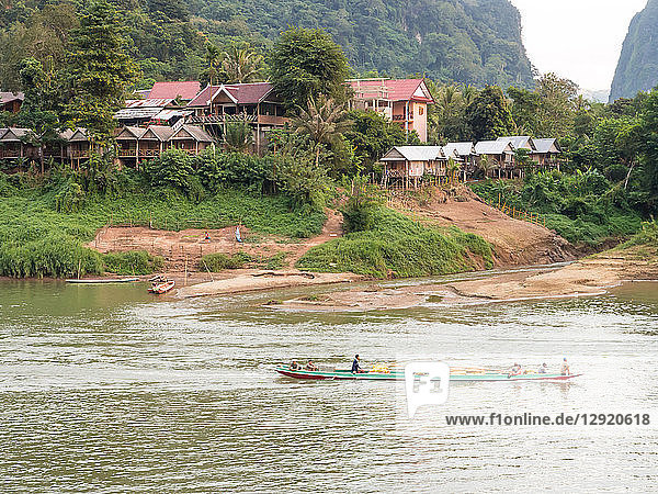 Riverboat and village  Nong Khiaw  Laos  Indochina  Southeast Asia  Asia