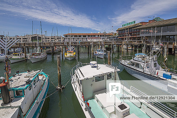 Boats and restaurants in Fishermans Wharf harbour  San Francisco  California  United States of America  North America
