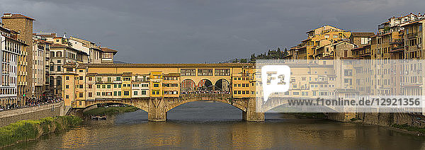A panorama of the Ponte Vecchio bridge spanning the Arno River in Florence  UNESCO World Heritage Site  Tuscany  Italy