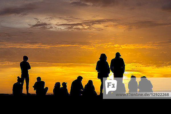 Silhouette of people enjoying sunset at Cape Saint-Vincent  the most southwestern point of Europe  Sagres  Algarve  Portugal  Europe
