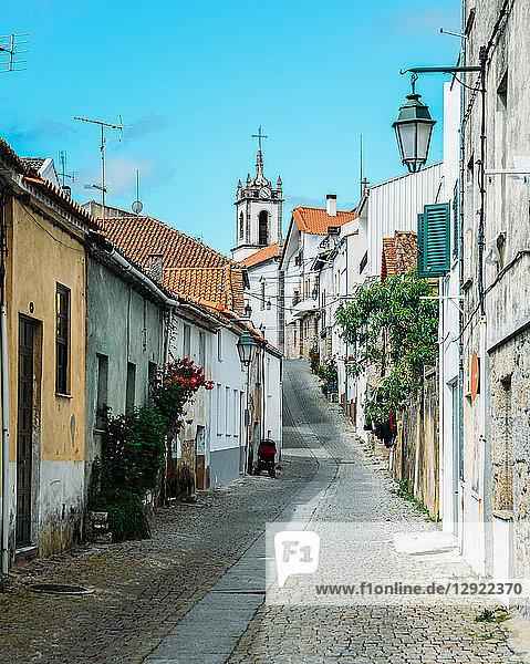 Narrow cobblestone street looking towards Santiago Church in Belmonte  Castelo Branco  Portugal  Europe