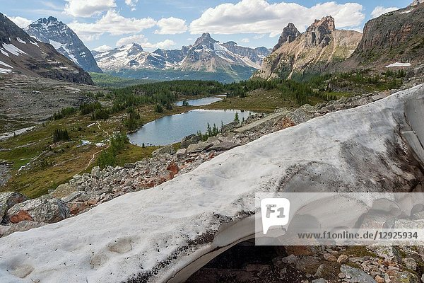 Remaining ice sheet in spring from glacier on Glaciar Peak. Lake O`Hara area with Lake Oesa in the background. British Columbia (border to Alberta)  Yoho National Park  Canada.