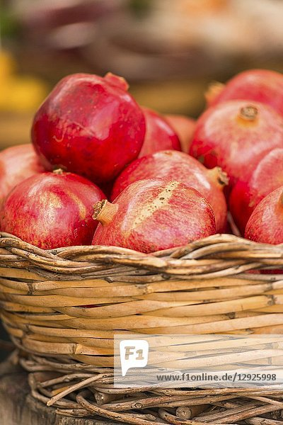 Pomegranates in basket at Market stall at Campo de' Fiori Market  Rome  Italy.