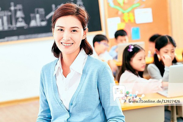 Female teachers and the pupils in the classroom