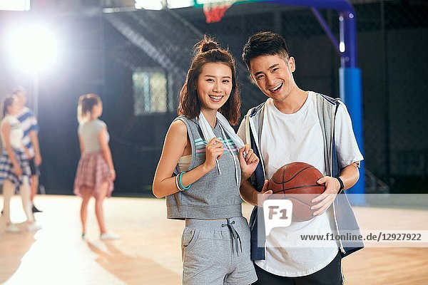 Young men and women in the basketball stadium