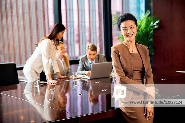Business men and women in the conference room