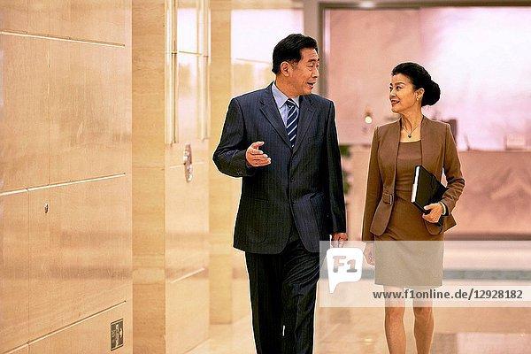 Business men and women in the corridor