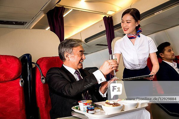 Business people eat on the plane