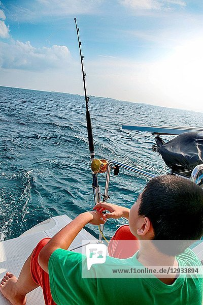 Sea fishing boy