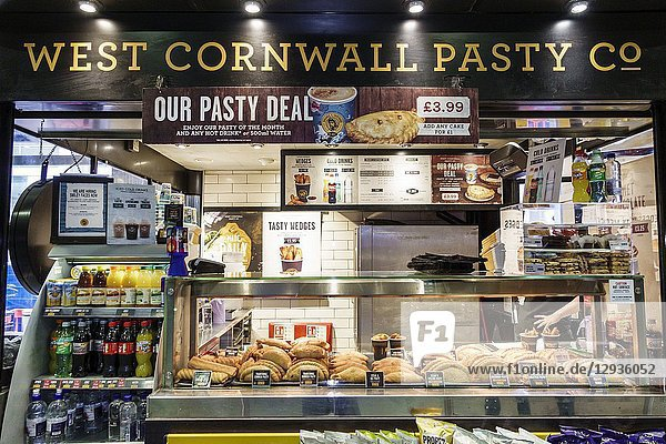 United Kingdom Great Britain England  London  South Bank  Waterloo Station  West Cornwall Pasty Co.  kiosk  baked pastry pastie  traditional food  regional cuisine  counter  beverages  special