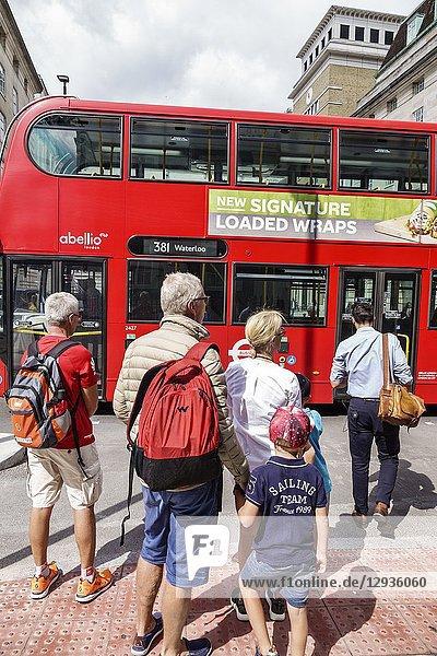 United Kingdom Great Britain England  London  South Bank  Lambeth  double-decker bus  public transportation  man  woman  boy  family