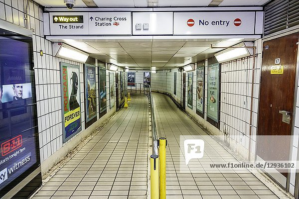 United Kingdom Great Britain England  London  Charing Cross Underground Station subway tube  public transportation  inside  exit hallway  sign  advertisement poster  empty vacant
