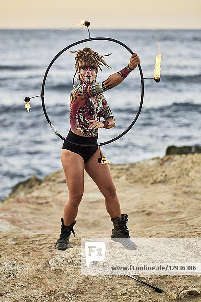 Fire dancer with body painting on the beach  Hersonissos  Crete  Greece