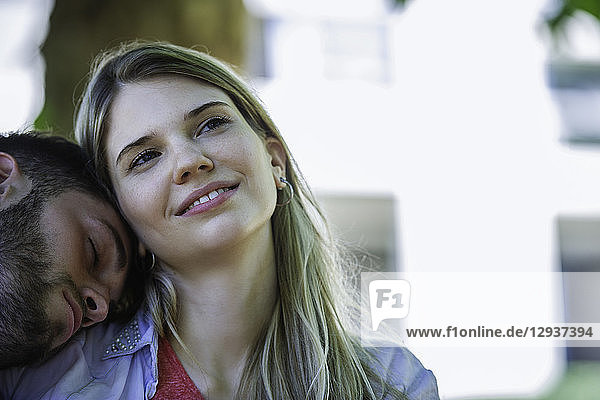 Man relaxing on the woman's shoulder