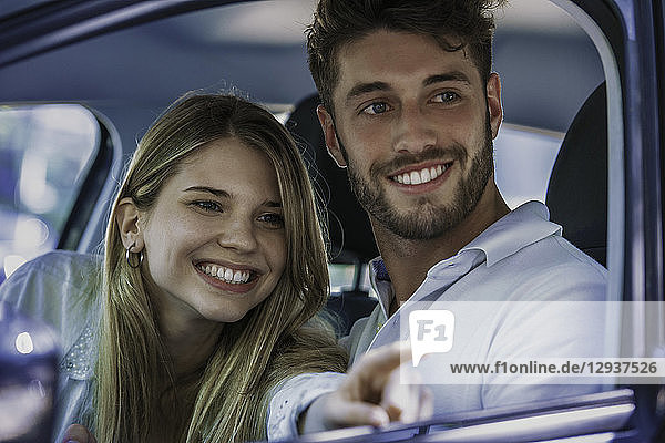 Smiling couple sitting in car