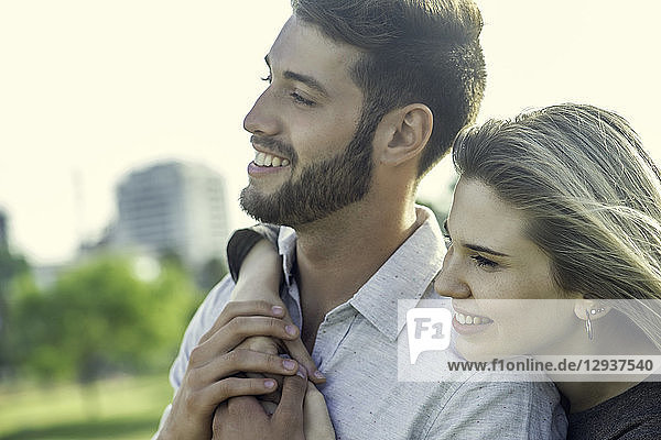 Couple embracing each other in park