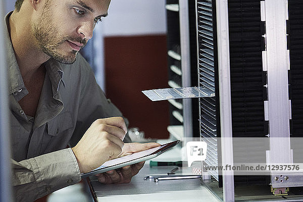 Close-up of engineer looking at chip in office
