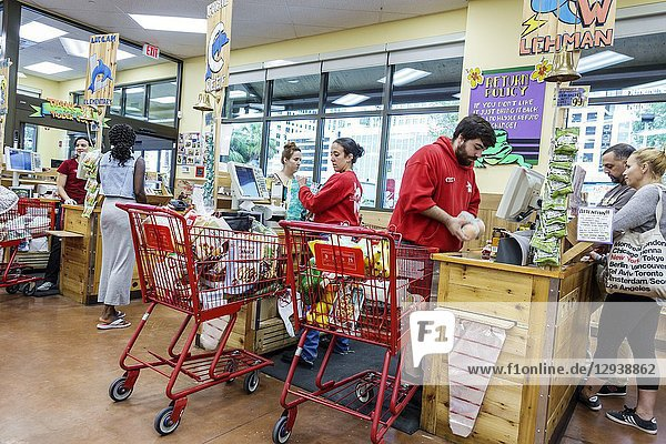 Florida  Miami  Trader Joe's supermarket grocery store food  inside  shopping  checkout line queue cashier  man  woman  cart trolley