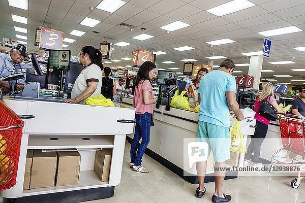 Florida  Miami  Little Havana  Calle Ocho  Sedano's supermarket grocery store food  inside  shopping  checkout line queue cashier  Hispanic  woman  employee uniform