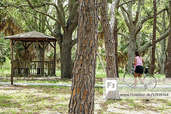 Florida  St. Saint Petersburg  Bay Pines  War Veterans Memorial Park  gazebo  woman  bicycle  trees