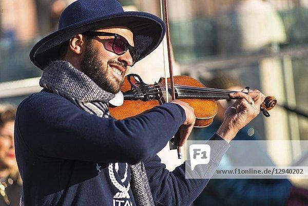 An italian street entertainer serenading on piazza Venezia  Rome. Lazio  Italy.