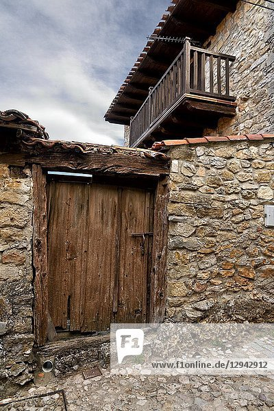 Old wooden door and balcony in Calatañazor. Soria. Castilla León. Spain. Europe.