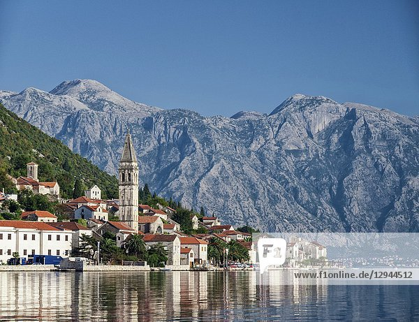 Perast traditional balkan village mountain landscape by kotor bay in montenegro.